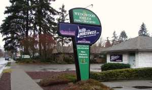 The original real estate sign for Balch's real estate office at 8044 35th Ave NE is now used by the current businesses.