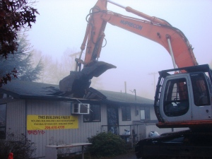 The building at 8605 35th Ave NE was demolished on November 26, 2013. See the Wedgwood Community Council webpage for more photos.
