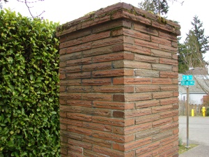 The brick gatepost on NE 86th Street at the corner of 30th Ave NE marks the entrance to Balch's Wedgwood #4 section of housing.