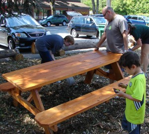 Wedgwood Community Council volunteers set up a picnic place with tables at Wedgwood's Future Park, corner of NE 86th Street.