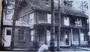 Mr. Thorpe's log cabin as it looked in the 1930s after the Jesuits began holding Mass there. When Balch purchased the forty-acre tract it had been preserved with only this one structure on the property.