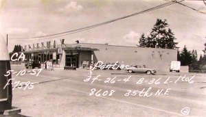 Evans Thriftway was in a 1946 grocery building which was remodelled and expanded in 1956-1957 and renamed for owner Russ Evans. Photo courtesy of Puget Sound Regional Archives. The writing on the photo is the legal description with block number and address.