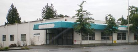 By 2007 the old grocery building at 8606 35th Ave NE was at the end of its useful life. It stood vacant while a redevelopment project was on hold.