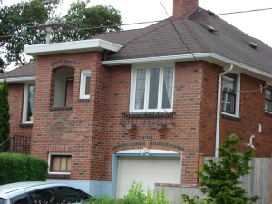 Neighbors bought the Sherman property and built this brick house in place of it in 1930.