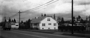The Herkenrath house as seen here in 1958, was on the present site of the Wedgwood Post Office. Photo #75875, Seattle Municipal Archives.