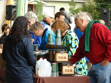 Bill Hunter Jr. (red sweatshirt) was the Hunter family liaison with the Gathering Place Project.  He is shown here on September 17, 2011, enjoying Tully's Coffee at the Celebration program.