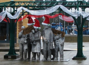 The Waiting for the Interurban statue held Doomsday signs on December 21, 2012.