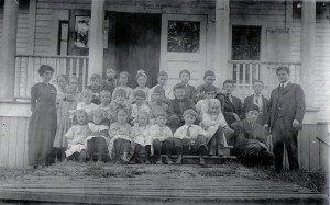 By 1914 the Maple Leaf School had two classrooms, one for younger and one for older children. Kelly, eldest of the Nishitani children, is in the front row next to teacher Mr. Thomas. Kelly's siblings had not yet been brought from Japan.