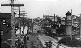 The early Fremont Bridge was a wooden trestle. This 1903 view to the north as we cross the bridge into Fremont shows the lumber mill in the foreground and B.F. Day School on the horizon. Photo courtesy of HistoryLink Essay 3309.