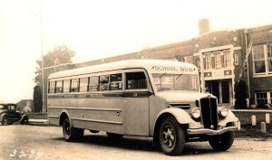 The Maple Leaf School at 3212 NE 100th Street was completed in 1926. This 1930's photo shows the school bus for the wide service area from Lake City Way to Sand Point Way.