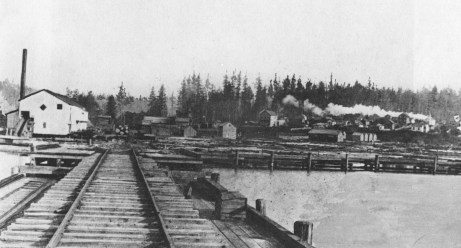 Looking north from Union Bay, we see the sawmill with the Town of Yesler on the hillside which would later become Laurelhurst.  Photo courtesy of the Seattle Public Library.
