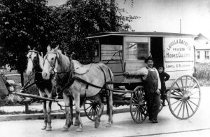 Ole Blindheim and his cousin Ole Lowell (shown here with his son Henry Lowell who was born in 1910) used this wagon for their dairy business circa 1916.