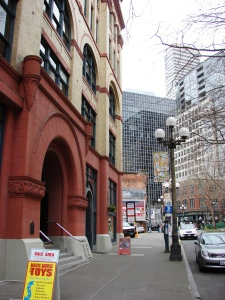 The Mutual Life Building (at left) is in Pioneer Square on the former site of Yesler's Cookhouse where marines were stationed during the Battle of Seattle.