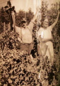 Roy and Anna Land with their garden produce in the 1930s. Mr. Land is holding up a bunch of rhubarb. In the 1930s people tried to live as cheaply as possible by growing and canning food.