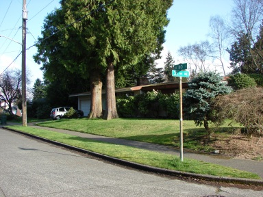 "Before NE 80th Street was put through, an old house was ""in the road"" at the corner of 31st Ave NE."