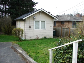 The house at 3805 NE 75th Street was built in 1926 and is now a little below the level of the street due to grading.