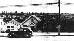 The Jacklin house in 1956 was lower than the level of 35th Ave NE.  The garage at left was built in 1922 as a grocery store.  The Jacklins kept a cow and sold milk.