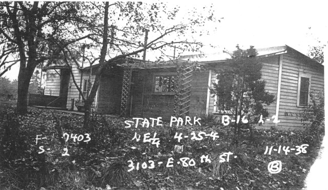 The House in the Road was built in 1907 on NE 80th Street at the corner of 31st Ave NE. Photo courtesy of the Puget Sound Regional Archives.