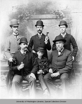 Real estate office of Samuel Crawford (seated at left) and Charles T. Conover (standing, center) in 1890. Walter Hamley, age 12 (seated, at center) worked as a messenger. Photo courtesy of University of Washington Special Collections, PH Coll 503.8.