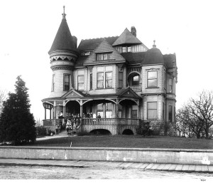 The Pontius family, early Seattleites who were real estate investors, built this large Queen Anne style home in 1889. It was given for use as the Ryther home in 1904. Photo by Asahel Curtis, Number 05330 in University of Washington Special Collections.