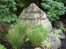 The entrance to the Inverness neighborhood is at about NE 87th Street off of Sand Point Way NE in northeast Seattle.