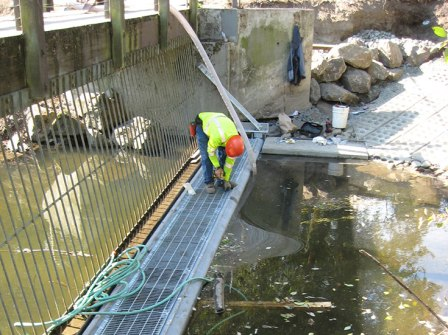 In the summer of 2013 a new maintenance walkway has been installed so that work crews can clear the trash rack (vertical bars) at Meadowbrook Pond.