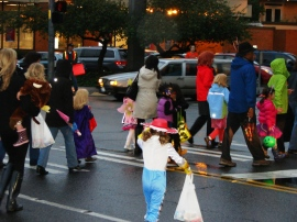 On Halloween in Wedgwood the kids come out in costume for trick or treat in the business district.