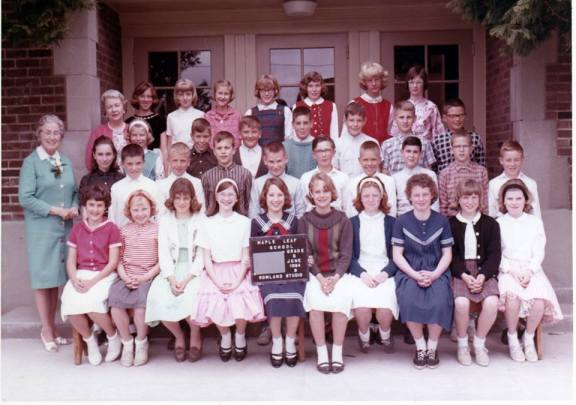 Maple Leaf School Sixth Grade, June 1964. Teacher Miss Jane Dayton (in blue) and Principal Katherine Maxwell (pink.) Valarie is in the back row, far right end. Photo courtesy of Philip Cereghino.