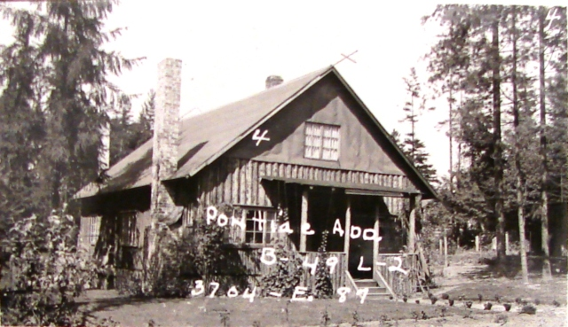 In 1932 Fred Reese built this log-sided house in Wedgwood.  The writing on the photo gives the plat name of Pontiac Addition, Block 49 Lot 2.