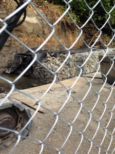 Slide area alongside the Burke-Gilman Trail will be bolstered with rock walls.  Photo courtesy of mountainstroh.com