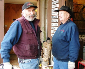 Bill Hunter Jr. with his father, William O. Hunter Sr., work together at the annual Christmas tree sales in Wedgwood.