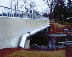 A creek runs under it: a section of 35th Ave NE has been rebuilt with a bridge structure so that the South Branch of Thornton Creek is daylighted.