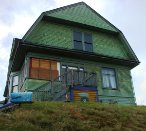 The Big Green House at 7321 35th Ave NE is boarded up and awaiting demolition.