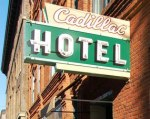 The Klondike Gold Rush Museum is in a historic building and still has its Cadillac Hotel sign.