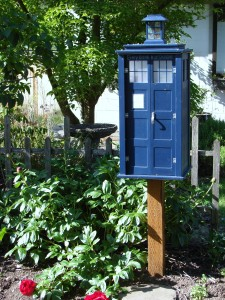 A garden setting enhances the appeal of this Little Free Library in the Wedgwood neighborhood.