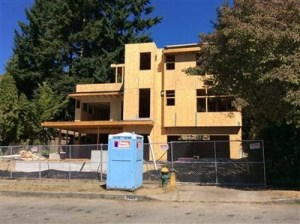 A three-story residence is being built at 7022 29th Ave NE in place of the original two-bedroom house.