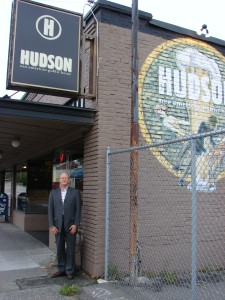 Here is David, the ever-helpful Husband of the Blogger, at Hudson Pub at 8014 15th Ave NE. The fence at right marks the second location of the Holman's house.