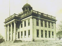 The Territorial University was built in 1861 at Fourth and University Streets.