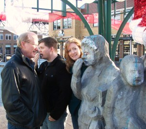 Valarie's husband, son-in-law and daughter with the Waiting for the Interurban statue in Fremont.