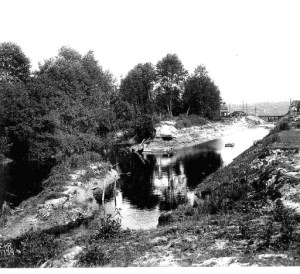 This 1906 photo shows how the creek had been enlarged into a canal large enough to send logs floating to mill, before the creation of the present-day ship canal.