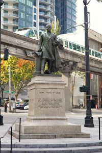 John H. McGraw Statue near Westlake Center in Seattle. The Monorail is in the background.
