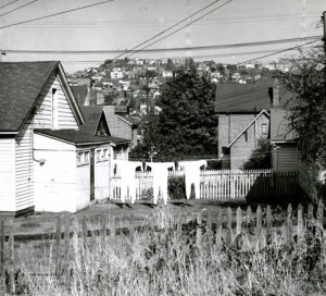 Looking north toward Queen Anne Hill from what is now the Flag Plaza of Seattle Center. This Werner Lenggenhager photo of 1957 also shows his appreciation of clothelines as a humorous touch to what would otherwise be a sad photo portent of doom for these houses.