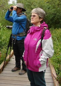 Walk leader Joe Sweeney spots a bird while Valarie's friend Debbie is taking in the beauty of Union Bay.