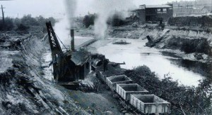 The McMullen building is at right, shown with steam shovels during canal construction. Photo courtesy of MOHAI 83.10.6934